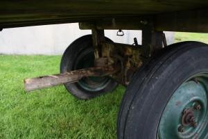 Notera att bommen har flera lägen för att ändra hjulbasen.